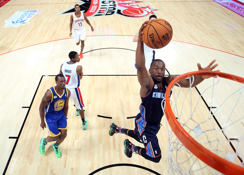Description of . HOUSTON, TX - FEBRUARY 15:  Kemba Walker #15 of the Charlotte Bobcats and Team Shaq goes up to dunk the ball in the BBVA Rising Stars Challenge 2013 part of the 2013 NBA All-Star Weekend at the Toyota Center on February 15, 2013 in Houston, Texas.  (Photo by Ronald Martinez/Getty Images)