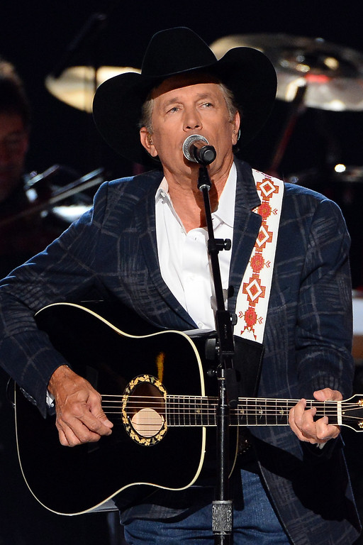 Description of . Singer/songwriter George Strait performs onstage during the 49th Annual Academy Of Country Music Awards at the MGM Grand Garden Arena on April 6, 2014 in Las Vegas, Nevada.  (Photo by Ethan Miller/Getty Images)