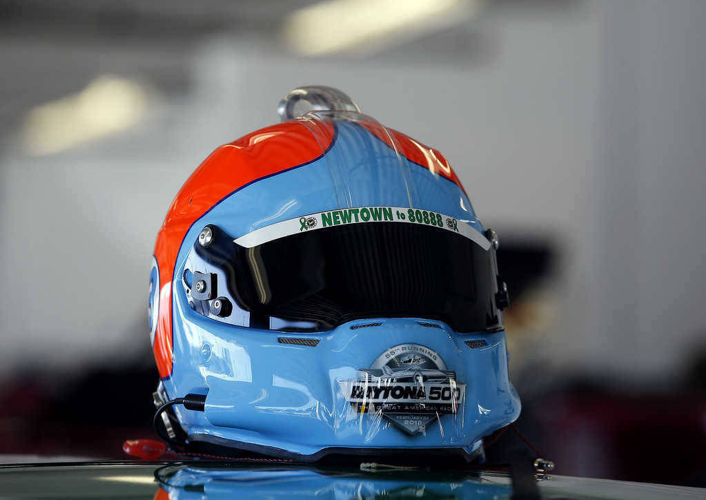 . DAYTONA BEACH, FL - FEBRUARY 20:  The helmet of Michael Waltrip, driver of the #26 Sandy Hook School Support Fund Toyota, sits on top of his car in the garage area during practice for the NASCAR Sprint Cup Series Daytona 500 at Daytona International Speedway on February 20, 2013 in Daytona Beach, Florida.  (Photo by Chris Graythen/Getty Images)