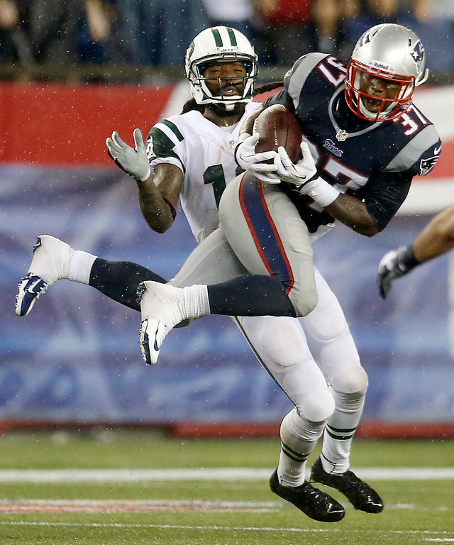 Description of . New England Patriots cornerback Alfonzo Dennard (37) intercepts a pass intended for New York Jets wide receiver Clyde Gates, rear, during the fourth quarter of an NFL football game Thursday, Sept. 12, 2013, in Foxborough, Mass. (AP Photo/Elise Amendola)