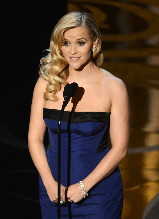 Description of . Actress Reese Witherspoon presents onstage during the Oscars held at the Dolby Theatre on February 24, 2013 in Hollywood, California.  (Photo by Kevin Winter/Getty Images)
