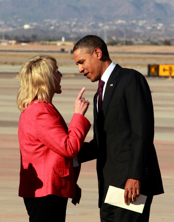 Description of . In this Jan. 25, 2012 file photo, Arizona Gov. Jan Brewer points during an intense conversation with President Barack Obama after he arrived at Phoenix-Mesa Gateway Airport in Mesa, Ariz. Asked moments later what the conversation was about, Brewer, a Republican, said: