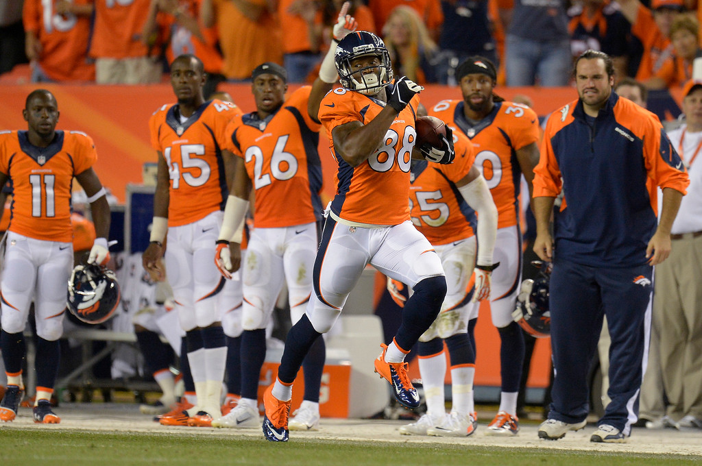 Description of . Denver Broncos wide receiver Demaryius Thomas (88) makes a run down the sidelines in the third quarter. The Denver Broncos took on the Baltimore Ravens in the first game of the 2013 season at Sports Authority Field at Mile High in Denver on September 5, 2013. (Photo by John Leyba/The Denver Post)