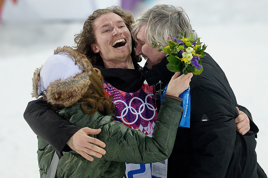 Description of . Gold medalist Iouri Podladchikov of Switzerland hugs his parents Yurii and Valentina after the men\'s snowboard halfpipe final. Podladchikov knocked off two-time defending gold medalist Shaun White as the event\'s top placer. Sochi 2014 Winter Olympics on Tuesday, February 11, 2014. (Photo by AAron Ontiveroz/The Denver Post)