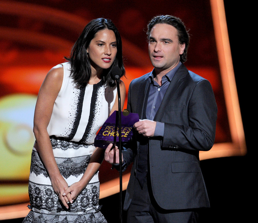 Description of . Actors Olivia Munn and Johnny Galecki speak onstage at the 39th Annual People's Choice Awards  at Nokia Theatre L.A. Live on January 9, 2013 in Los Angeles, California.  (Photo by Kevin Winter/Getty Images for PCA)
