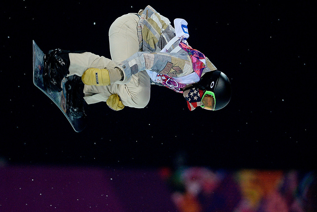 Description of . U.S.A. rider Shaun White rides during the men\'s snowboard halfpipe final. Sochi 2014 Winter Olympics on Tuesday, February 11, 2014. (Photo by AAron Ontiveroz/The Denver Post)