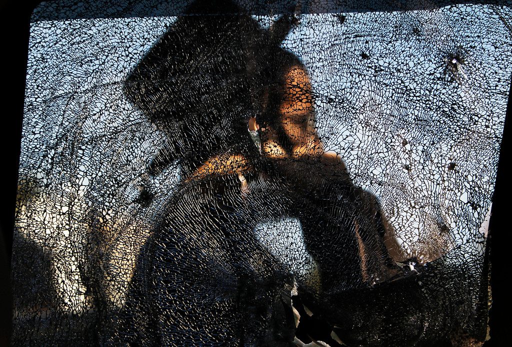 . An ultra-Orthodox Jewish man is seen through a damaged car window after a rocket fired from Gaza landed in the southern city of Ashdod November 16, 2012. Israel has started drafting 16,000 reserve troops, the military said on Friday, in a sign that violence could escalate further with Palestinian militants in the Gaza Strip. REUTERS/Amir Cohen