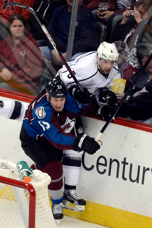 Description of . DENVER, CO. - JANUARY 22: Colorado Avalanche left wing Cody McLeod (55) checks Los Angeles Kings defenseman Jake Muzzin (6) into the glass during the second period. The Colorado Avalanche hosted the Los Angeles Kings at the Pepsi Center on January, 22, 2013.   (Photo By John Leyba / The Denver Post)