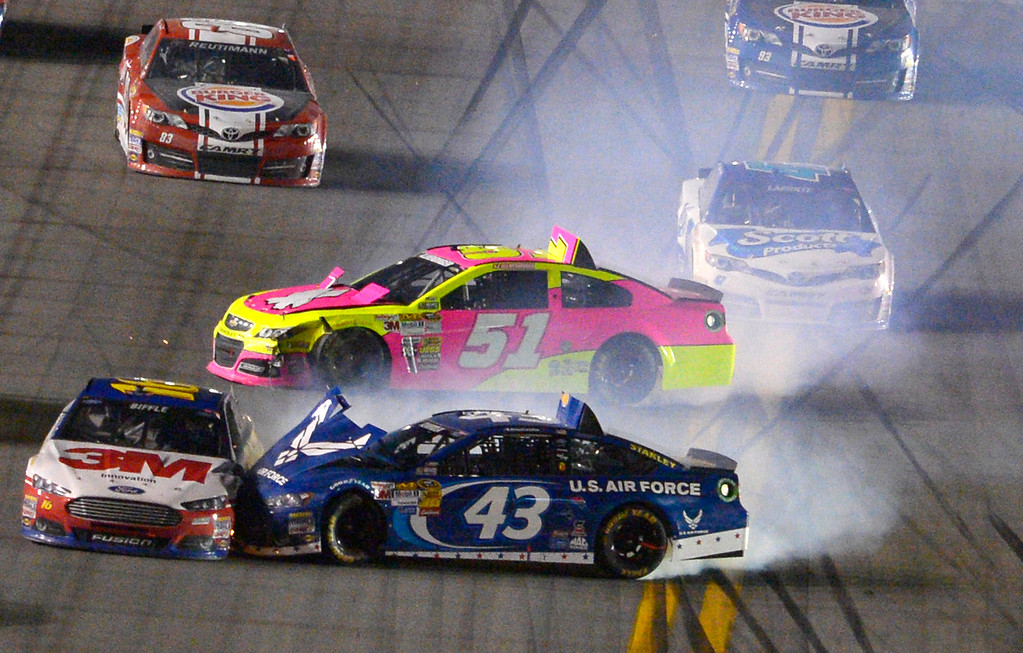 Description of . Greg Biffle (16), Aric Almirola (43) and A J Allmendinger (51) collide after coming out of Turn 4 during the NASCAR Sprint Cup auto race at Daytona International Speedway in Daytona Beach, Fla., Saturday, July 6, 2013. (AP Photo/Phelan M. Ebenhack)