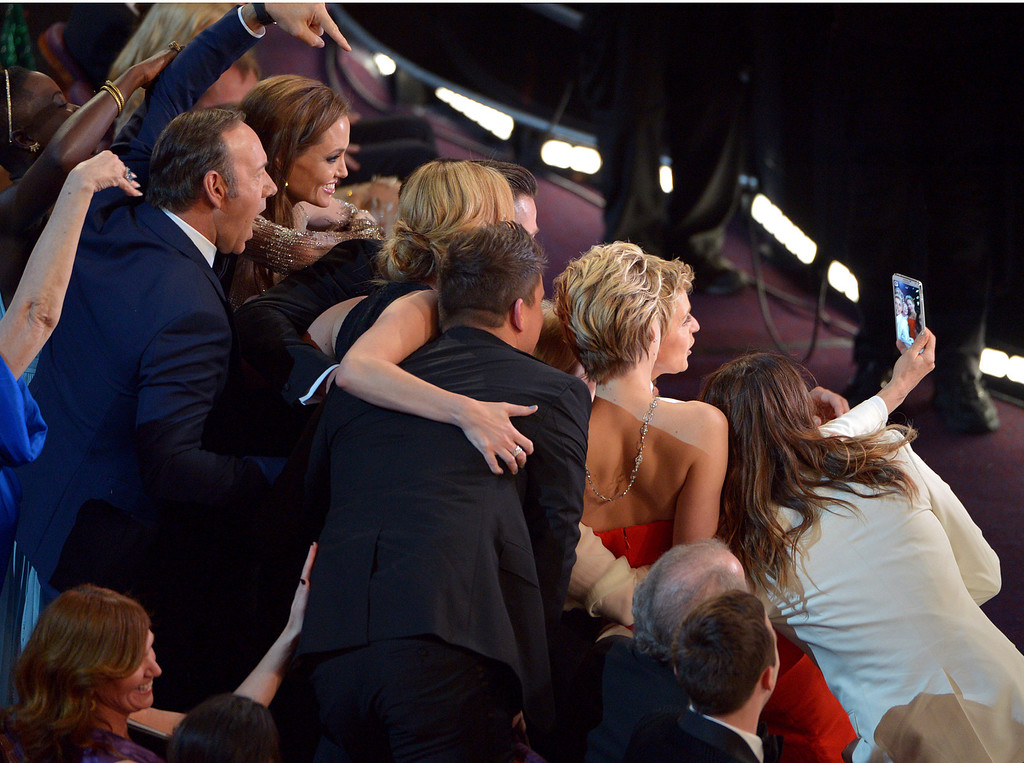 Description of . Kevin Spacey, from left, Angelina Jolie, Julia Roberts, Brad Pitt, Jennifer Lawrence, Ellen Degeneres and Jared Leto join other celebrities for a