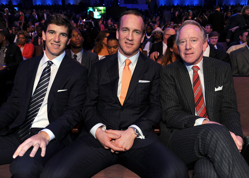Description of . Eli Manning of the New York Giants, left, Peyton Manning of the Denver Broncos, center, and former NFL player Archie Manning at the 2nd Annual NFL Honors on Saturday, Feb. 2, 2013 in New Orleans. (Photo by Jordan Strauss/Invision/AP)