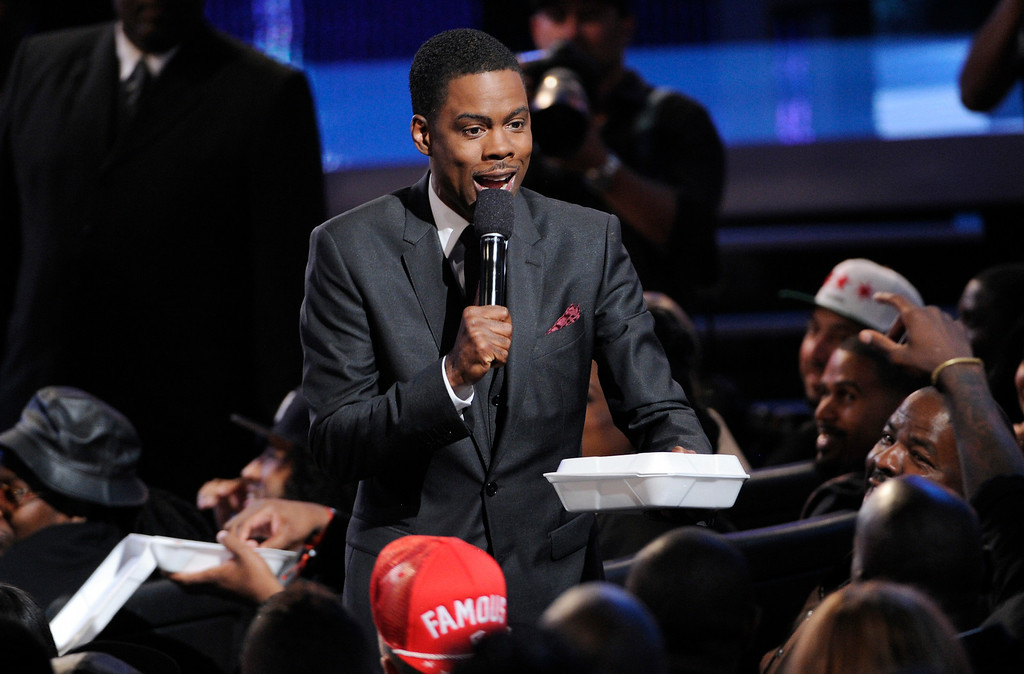 Description of . Host Chris Rock hands out fried chicken and waffles at the BET Awards at the Nokia Theatre on Sunday, June 29, 2014, in Los Angeles. (Photo by Chris Pizzello/Invision/AP)