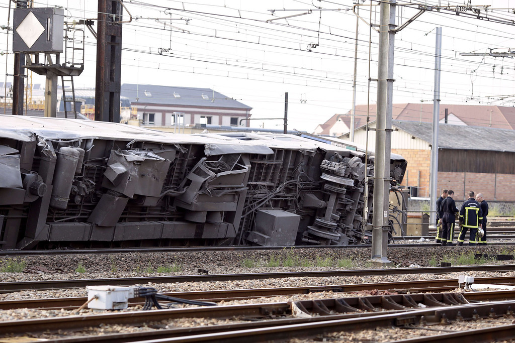 Description of . A picture shows a derailed wagon on the site of a train accident in the railway station of Bretigny-sur-Orge on July 12, 2013 near Paris.  AFP PHOTO /KENZO  TRIBOUILLARD/AFP/Getty Images