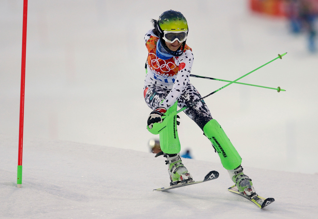 Description of . Peru's Ornella Oettl Reyes skis out in the first run of the women's slalom at the Sochi 2014 Winter Olympics, Friday, Feb. 21, 2014, in Krasnaya Polyana, Russia. (AP Photo/Charles Krupa)
