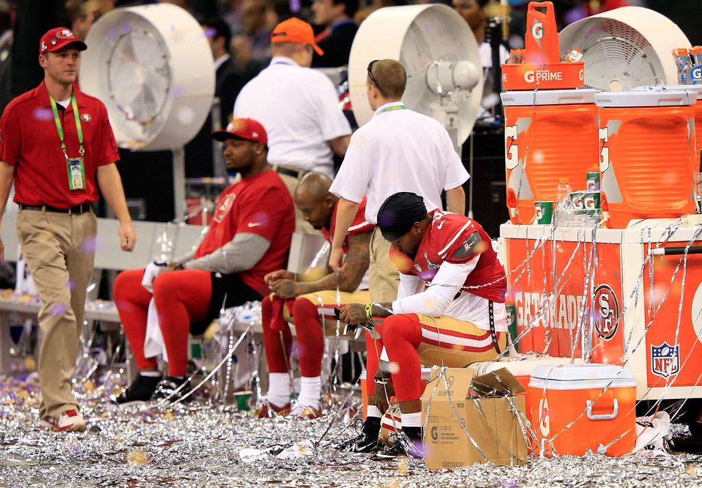 Description of . Members of the San Francisco 49ers sit on the bench after being defeated by the Baltimore Ravens during Super Bowl XLVII at the Mercedes-Benz Superdome on February 3, 2013 in New Orleans, Louisiana. The Ravens defeated the 49ers 34-31. (Photo by Jamie Squire/Getty Images)