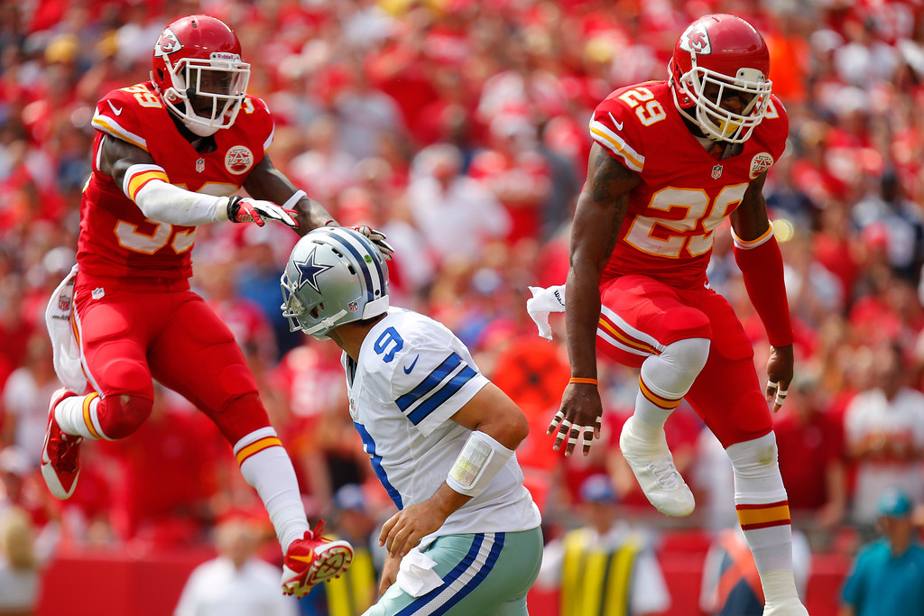 Description of . Husain Abdullah #39 and Eric Berry #29 of the Kansas City Chiefs attempt to knock down the pass from Tony Romo #9 of the Dallas Cowboys in the second quarter September 15, 2013 at Arrowhead Stadium in Kansas City, Missouri. (Photo by Kyle Rivas/Getty Images)