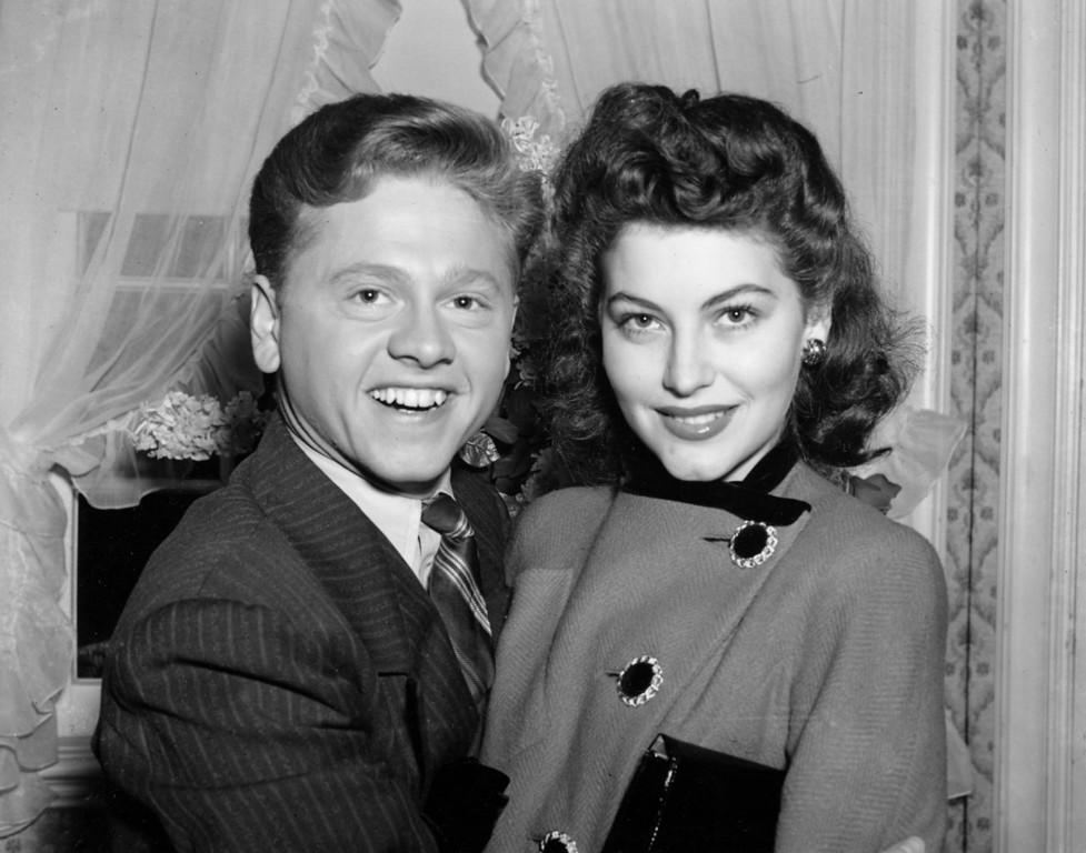 Description of . In this Jan. 5, 1942, file photo, Mickey Rooney, 21, Movieland's No. 1 box office star, and Ava Gardner, 19, of Wilson, N.C., pose together in Santa Barbara, Calif., shortly after the couple applied for a marriage license. (AP Photo/File)