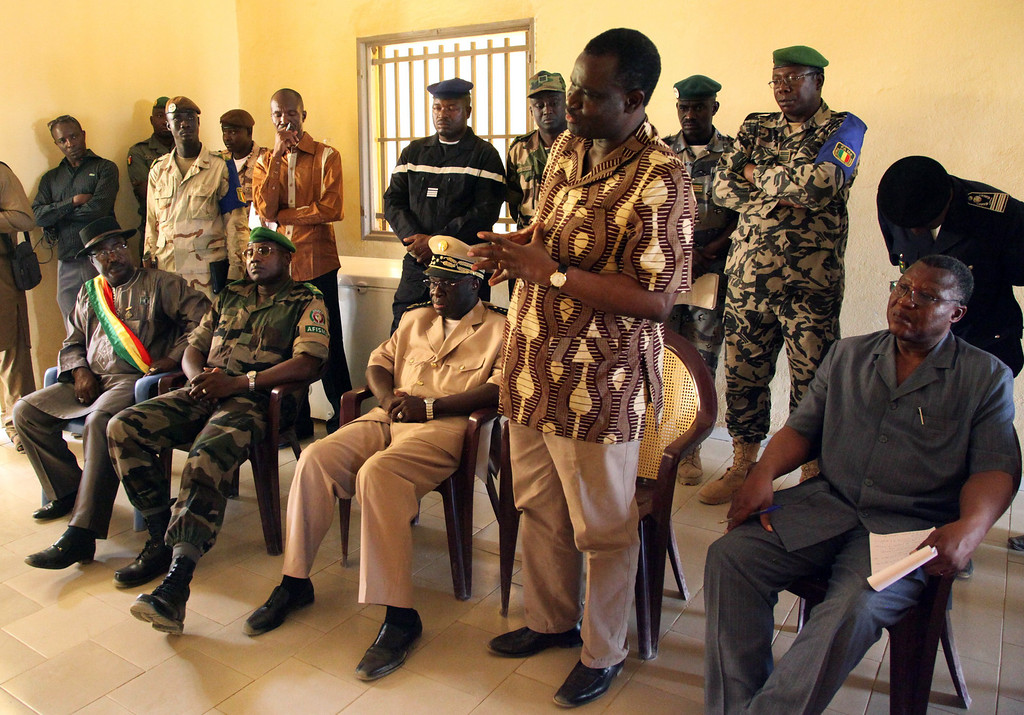 Description of . Burkinabe President of the Economic Community of West African States (ECOWAS) Commission, Kadre Desire Ouedraogo (4th R), speaks to military officers during a visit to Franco-African troops in Gao on April 21, 2013. Ouedraogo encouraged Franco-African troops in Mali to