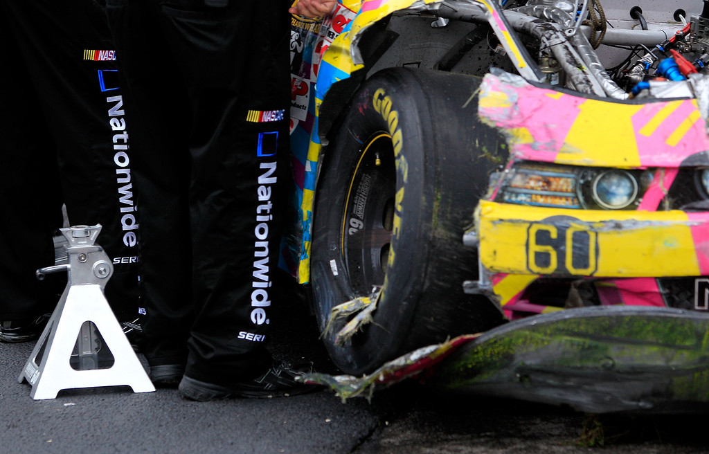 Description of . TALLADEGA, AL - MAY 04:  A detail of damage suffered by the #60 Roush Fenway Racing Ford driven by Travis Pastrana (not pictured) in the garage area after the car was knocked out of the race  during the NASCAR Nationwide Series Aaron's 312 at Talladega Superspeedway on May 4, 2013 in Talladega, Alabama.  (Photo by Sean Gardner/Getty Images)