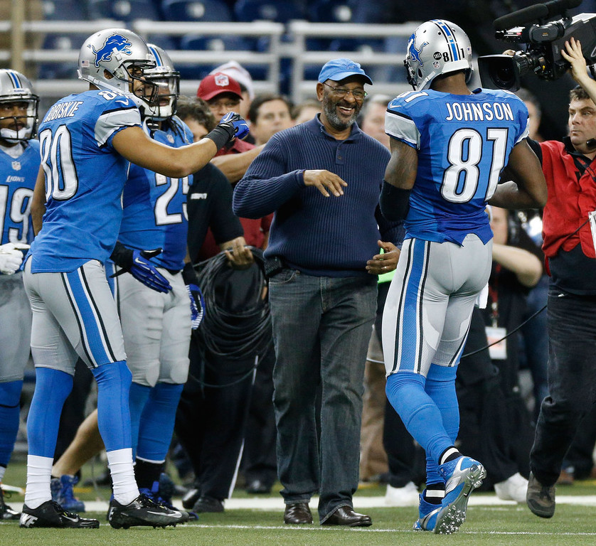 Description of . DETROIT, MI - DECEMBER 22:  Calvin Johnson #81 of the Detroit Lions celebrates breaking the NFL single season yardage record formally held by Jerry Rice with his father Calvin Johnson Sr. while playing the Atlanta Falcons at Ford Field on December 22, 2012 in Detroit, Michigan.  (Photo by Gregory Shamus/Getty Images)