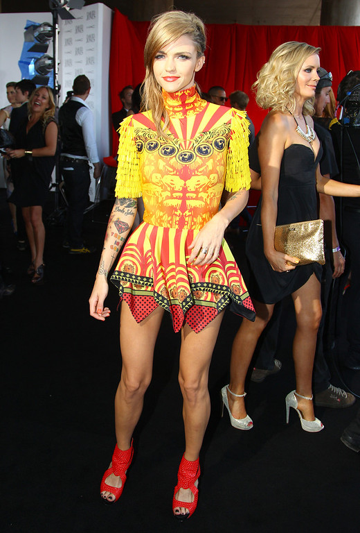 Description of . Ruby Rose arrives for the Australian music industry Aria Awards in Sydney, Thursday, Nov. 29, 2012. (AP Photo/Rick Rycroft)