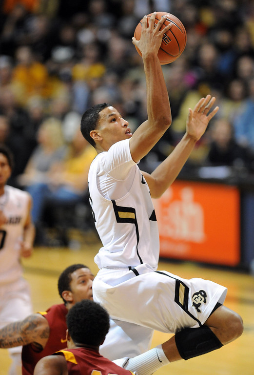 Description of . Andre Roberson of CU scores on a break away against USC during the second half of the January 10, 2013 game in Boulder.   Cliff Grassmick/Daily Camera