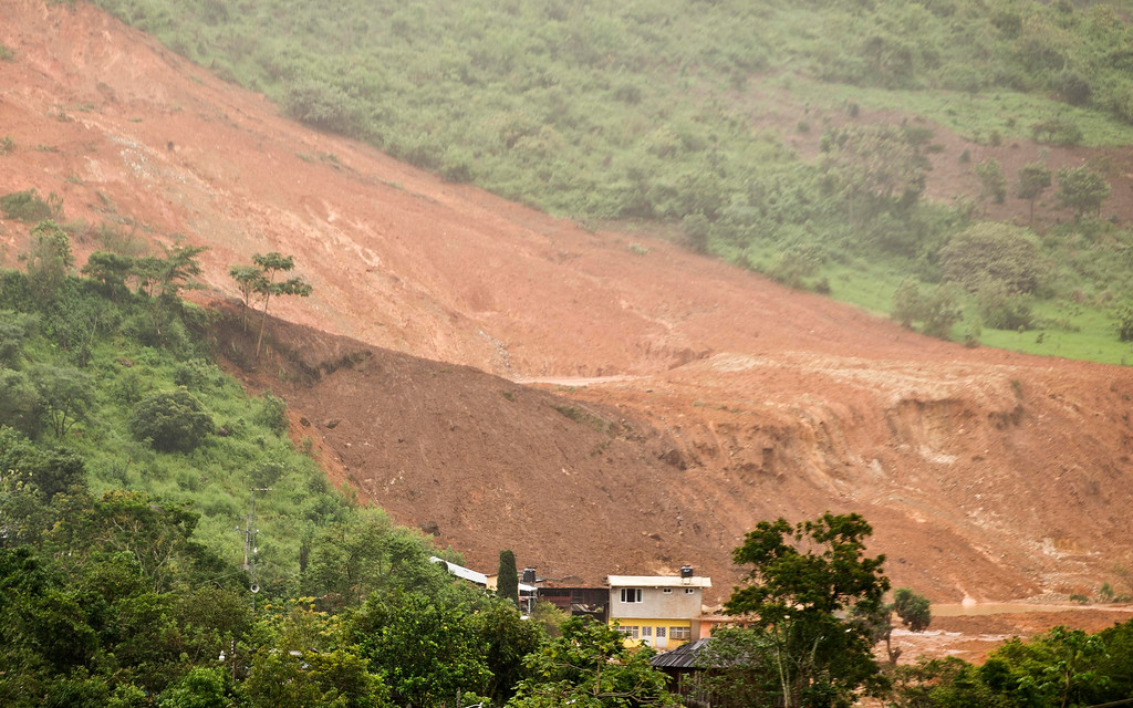 Description of . Panoramic view of the site of a landslide in La Pintada, state of Guerrero, Mexico, on September 19, 2013 as heavy rains hit the country.   AFP PHOTO/RONALDO Schemidt/AFP/Getty Images