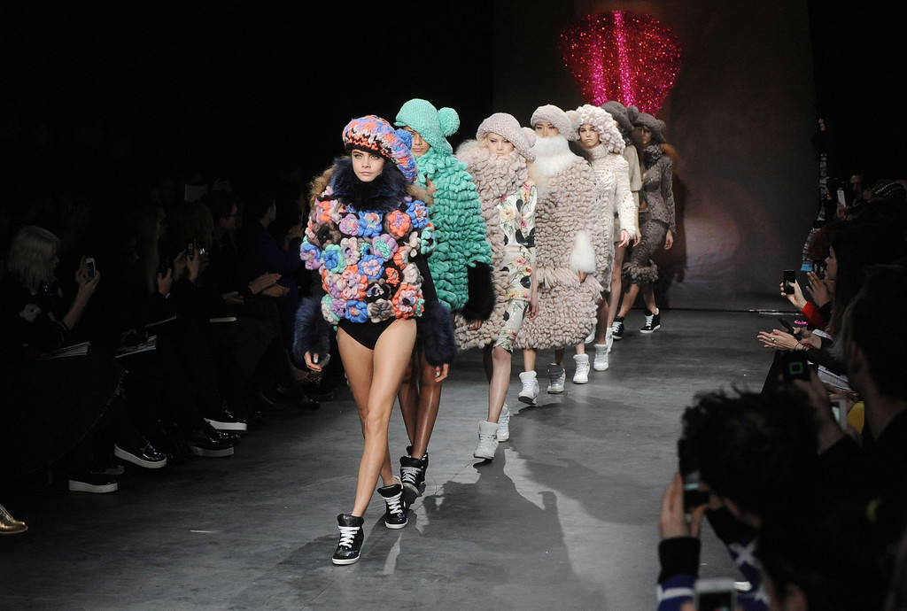 Description of . LONDON, UNITED KINGDOM - FEBRUARY 16: Cara Delevingne (L) walks the Runway at the Sister by Sibling presentation during London Fashion Week Fall/Winter 2013/14 at ICA on February 16, 2013 in London, England. (Photo by Stuart Wilson/Getty Images)