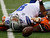 Dallas Cowboys quarterback Tony Romo (9) grimaces as he is sacked by Cincinnati Bengals defensive end Carlos Dunlap in the first half of an NFL football game, Sunday, Dec. 9, 2012, in Cincinnati. (AP Photo/Tom Uhlman)