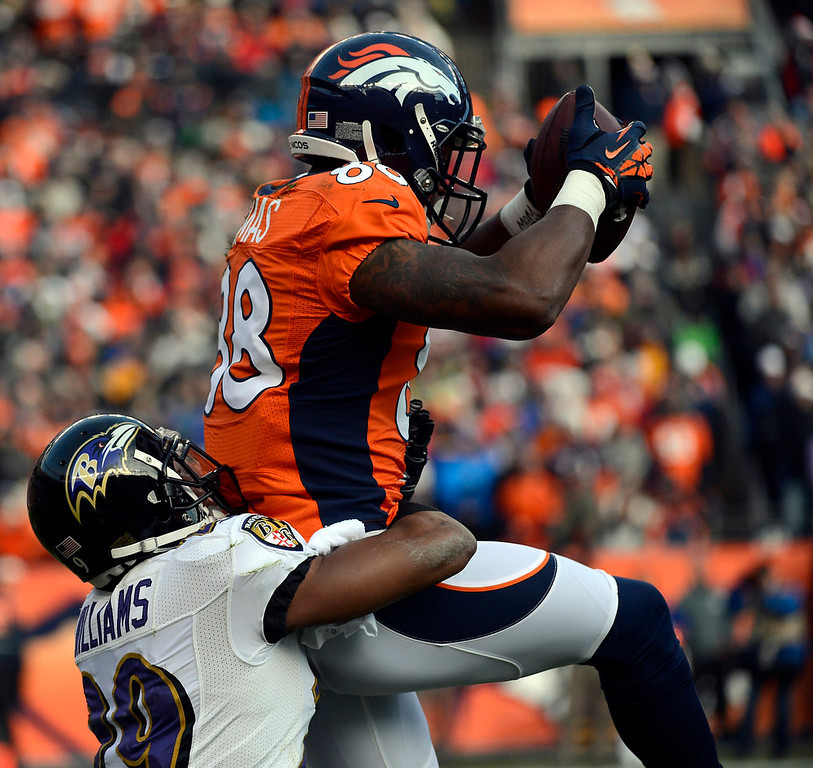 Description of . Denver Broncos wide receiver Demaryius Thomas (88) gets taken down by Baltimore Ravens cornerback Cary Williams (29) during the first half.  The Denver Broncos vs Baltimore Ravens AFC Divisional playoff game at Sports Authority Field Saturday January 12, 2013. (Photo by Tim Rasmussen,/The Denver Post)