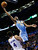 Denver Nuggets forward Corey Brewer (13) is fouled by Oklahoma City Thunder forward Nick Collison (4) as he shoots in the second quarter of an NBA basketball game in Oklahoma City, Tuesday, March 19, 2013. (AP Photo/Sue Ogrocki)
