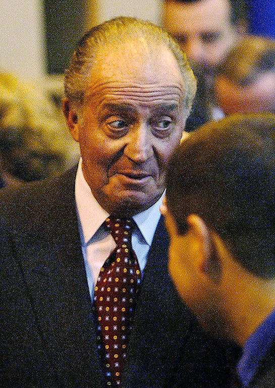 Description of . King of Spain Juan Carlos de Borbon reacts after being asked by journalists about the official announcement of their daughter Infanta Cristina's pregnancy, 09 December 2004, during a visit to inaugurate a new factory in the northern Spanish Basque village of Mondragon. RAFA RIVAS/AFP/Getty Images