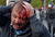 In this May 6, 2012 file photo, a wounded opposition protester winces in pain during a rally in Moscow. Riot police in Moscow began arresting protesters who were trying to reach the Kremlin in a demonstration on the eve of Vladimir Putin's inauguration as president. (AP Photo/Mikhail Metzel, File)