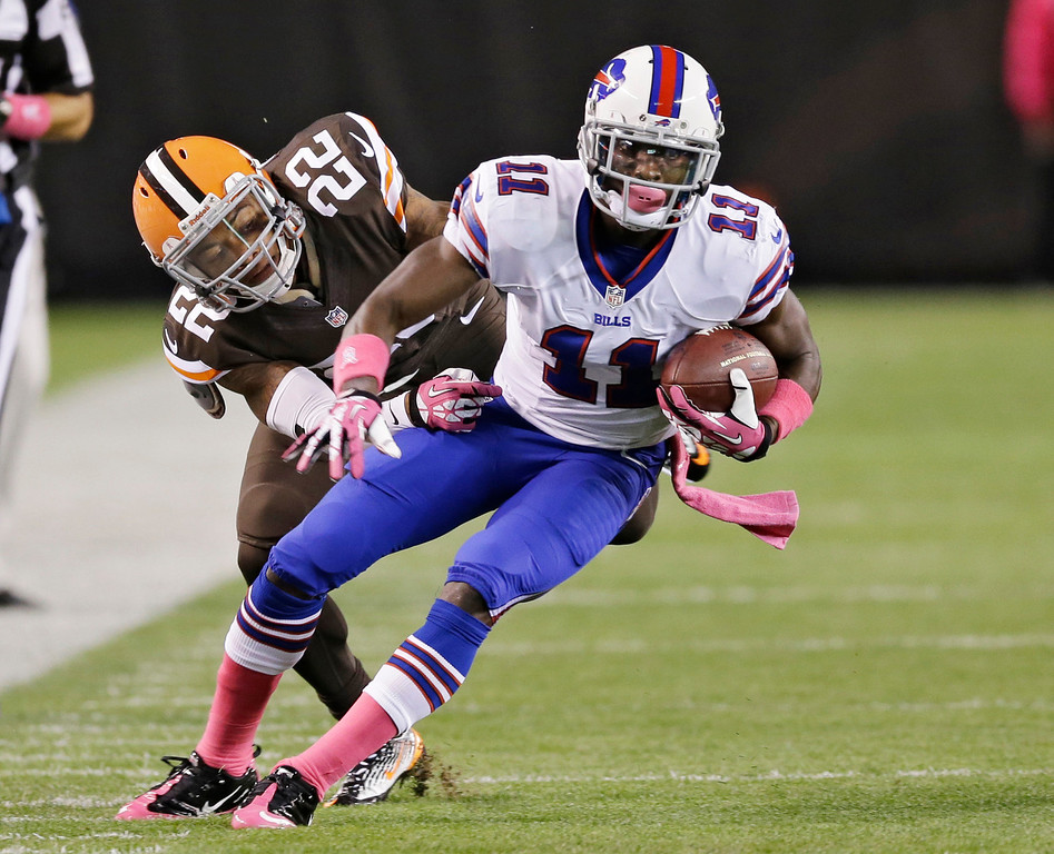 Description of . Buffalo Bills wide receiver T.J. Graham (11) turns after a reception against Cleveland Browns cornerback Buster Skrine (22) during the first quarter of an NFL football game Thursday, Oct. 3, 2013, in Cleveland. (AP Photo/Tony Dejak)