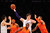 Pau Gasol (C)of the Los Angeles Lakers grabs the ball against the New York Knicks during their NBA game at Staples Center in Los Angeles, California, on December 25, 2012.  ROBYN BECK/AFP/Getty Images