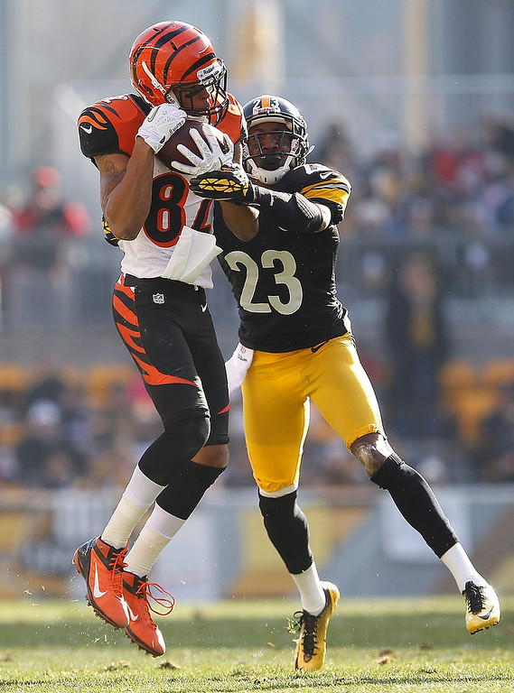 Description of . Jermaine Gresham #84 of the Cincinnati Bengals makes a second quarter catch in front of Keenan Lewis #23 of the Pittsburgh Steelers at Heinz Field on December 23, 2012 in Pittsburgh, Pennsylvania. (Photo by Gregory Shamus/Getty Images)