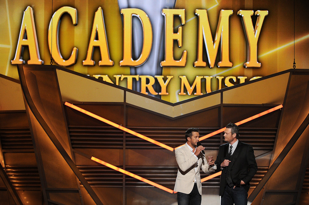 Description of . Hosts Luke Bryan, left, and Blake Shelton speak on stage at the 49th annual Academy of Country Music Awards at the MGM Grand Garden Arena on Sunday, April 6, 2014, in Las Vegas. (Photo by Chris Pizzello/Invision/AP)
