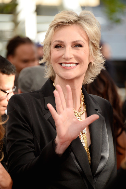 Description of . Actress Jane Lynch arrives at the 65th Annual Primetime Emmy Awards held at Nokia Theatre L.A. Live on September 22, 2013 in Los Angeles, California.  (Photo by Frazer Harrison/Getty Images)