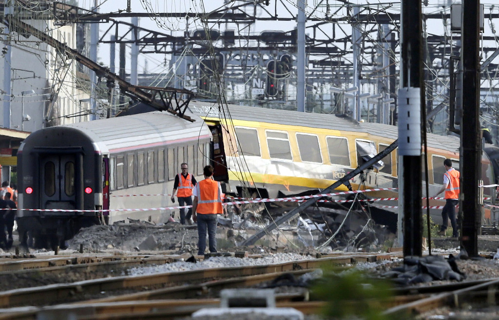 Description of . Rescuers work on the site of a train accident in the railway station of Bretigny-sur-Orge on July 12, 2013 near Paris. At least seven people were dead and dozens injured after a speeding train split in two and derailed at a station in the southern suburbs of Paris, officials said. AFP PHOTO /KENZO TRIBOUILLARD/AFP/Getty Images