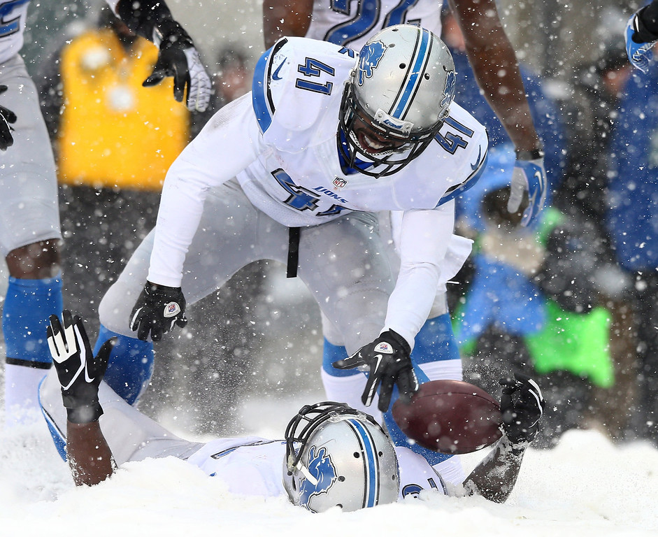 Description of . Jeremy Ross #12 of the Detroit Lions celebrates his touchdown with teammate Theo Riddick #41 in the third quarter against the Philadelphia Eagles on December 8, 2013 at Lincoln Financial Field in Philadelphia, Pennslyvania.  (Photo by Elsa/Getty Images)