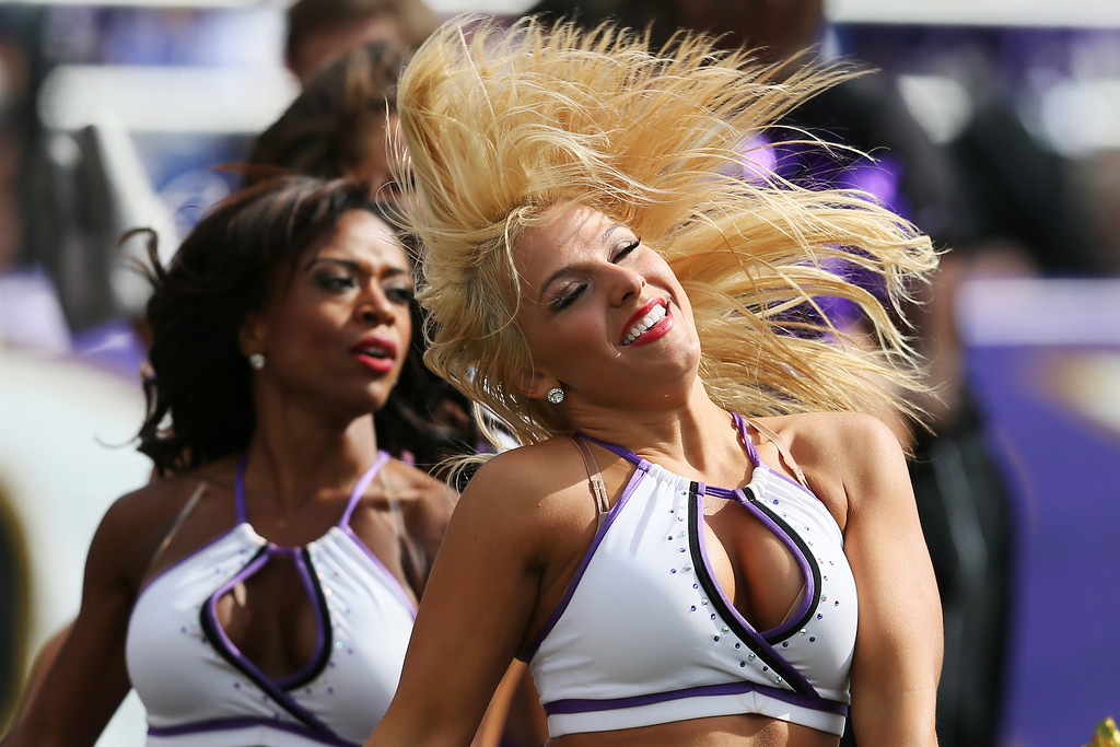 Description of . Baltimore Ravens cheerleaders preform during the second half of the Ravens and Cleveland Browns game at M&T Bank Stadium on September 15, 2013 in Baltimore, Maryland.  (Photo by Rob Carr/Getty Images)