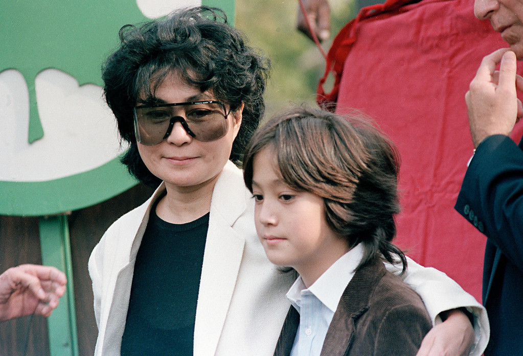 Description of . Sean Lennon and his mother Yoko Ono are seen at the dedication of Strawberry Fields in memory of John Lennon, Oct. 9, 1985, in Central Park in New York. (AP Photo/G. Paul Burnett)