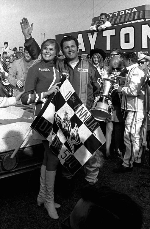Description of . Lee Roy Yarbrough holds his trophy and waves in victory lane after winning the Daytona 500 stock car race February 24, 1969 at the Daytona International Speedway.  Yarbrough, of Columbia, S.C., drove a 1969 Ford to win the 200-lap race over a 2.5 mile course.  (AP Photo/TY)
