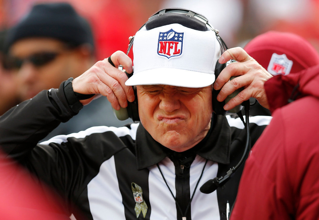 Description of . Referee Walt Coleman wears a headset to review a play during the first half of an NFL football game between the San Diego Chargers and the Kansas City Chiefs at Arrowhead Stadium in Kansas City, Mo., Sunday, Nov. 24, 2013. (AP Photo/Ed Zurga)