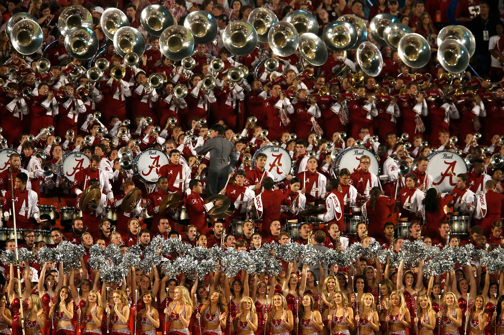 Description of . The Alabama Crimson Tide band and cheerleaders perform during the first quarter of the NCAA National Championship college football game against the Notre Dame Fighting Irish in Miami, Florida, January 7, 2013.  REUTERS/Mike Segar