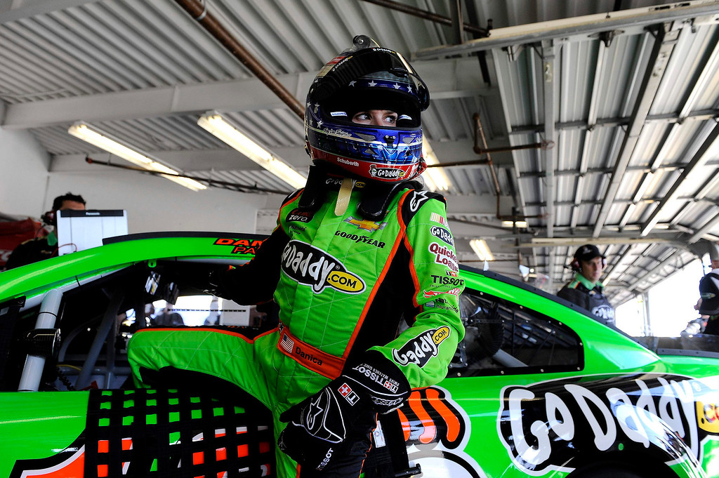. NASCAR Sprint Cup Series driver Danica Patrick, of the number 10 car, exits her car to speak with crew members in the garage during practice for the Daytona 500 at Daytona International Speedway in Daytona Beach, Florida, February 20, 2013. REUTERS/Brian Blanco