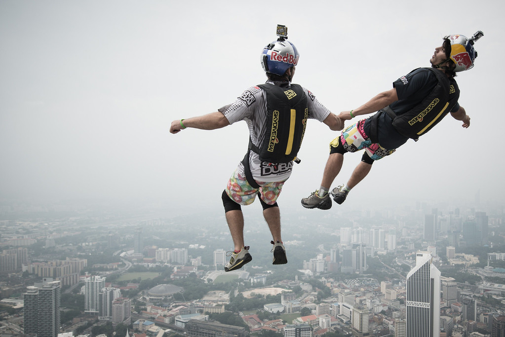 Description of . Base jumper Vincent Philippe Benjamin Reffet (R) and Frederic Yves Fugen (L) from France leap from the 300-metres Open Deck of the Malaysia's landmark Kuala Lumpur Tower during the International Tower Jump in Kuala Lumpur on September 27, 2013. Some 103 professional base jumpers from 20 countries are taking part in the annual event. AFP PHOTO / MOHD RASFANMOHD RASFAN/AFP/Getty Images