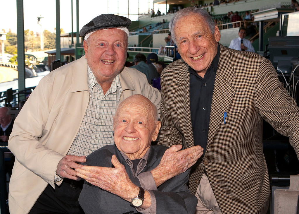 Description of . In this Sunday, March 30, 2014, file photo, entertainment icons Dick Van Patten, left, and Mel Brooks flank Mickey Rooney at Santa Anita Park, in Arcadia Calif.  (AP Photo/Benoit Photo, File)