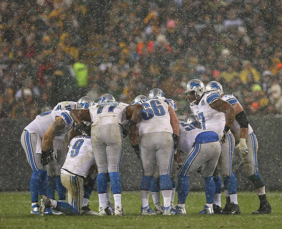 . GREEN BAY, WI - DECEMBER 09: Matthew Stafford #9 of the Detroit Lions calls a play in the huddle as it snows during a game against Green Bay Packers at Lambeau Field on December 9, 2012 in Green Bay, Wisconsin.  (Photo by Jonathan Daniel/Getty Images)