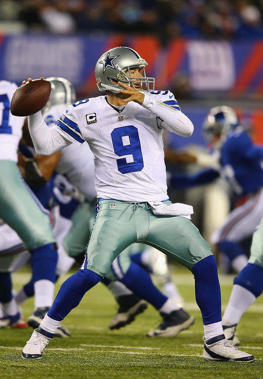 Description of . Tony Romo #9 of the Dallas Cowboys passes against the New York Giants during their game at MetLife Stadium on November 24, 2013 in East Rutherford, New Jersey.  (Photo by Al Bello/Getty Images)